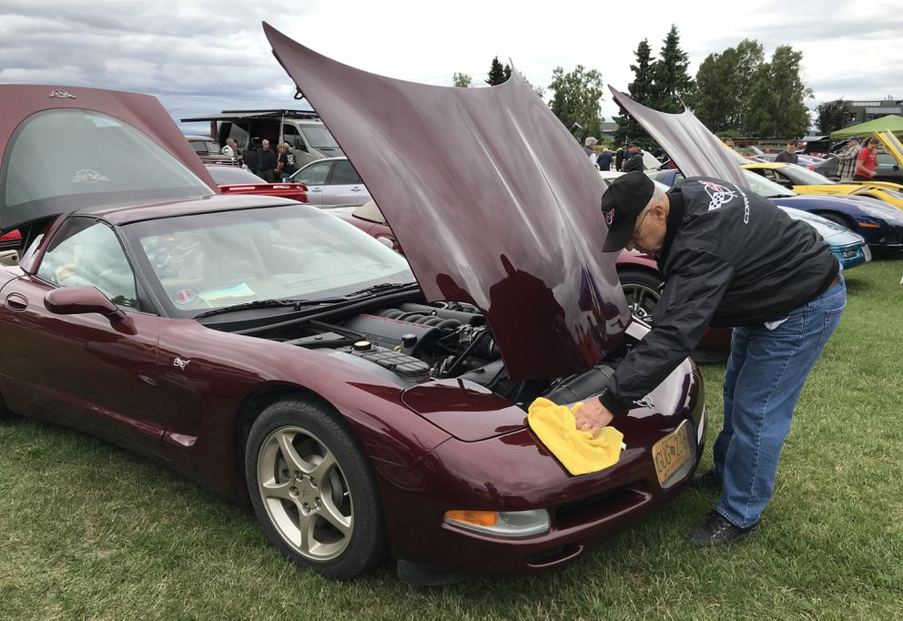 Wes Frye polishes the bumper of his 2003 Chevrolet Corvette 50th Anniversary Edition during the 40th annual Jay Ofsthun Memorial Show and Shine on the west end of the Delany Park Strip on Sunday, Aug. 5, 2018. About 350 vehicles from street rods, sports cars, muscle cars, trucks, original cars, to tractors participated in the largest car show in Alaska. (Bill Roth / ADN)