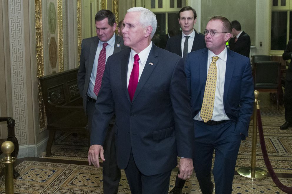Vice President Mike Pence, second from left, departs with White House senior adviser Jared Kushner, and incoming White House Chief of Staff Mick Mulvaney as they depart for the night without a bill that would pay for President Donald Trump's border wall and avert a partial government shutdown, on Capitol Hill, Friday, Dec. 21, 2018 in Washington. (AP Photo/Alex Brandon)