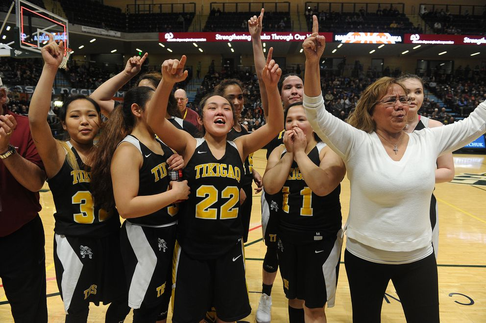 Coach Ramona Rock, right, and her team celebrate their victory. (Photo by Bob Hallinen)