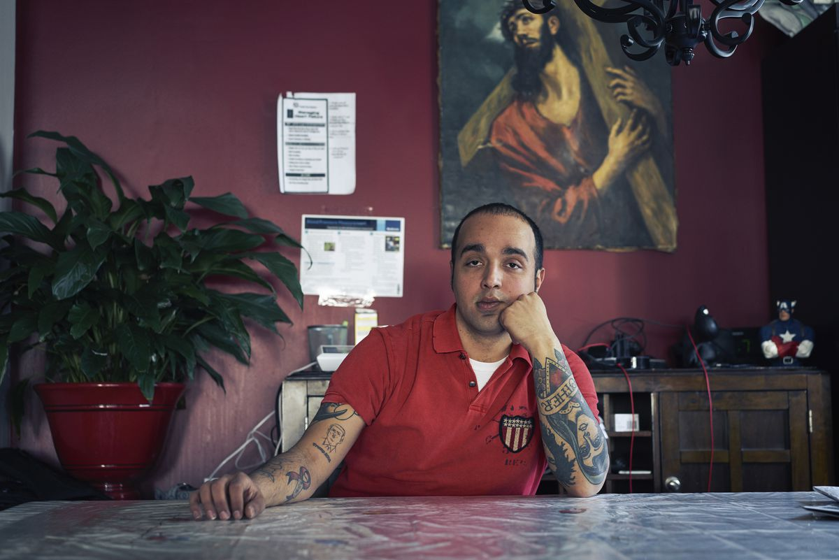 """Sal Oliva, who is gay and cited the Orlando nightclub shooting, saying""""I was so happy"""" upon hearing of the new Trump immigration policy, is pictured at home in Staten Islandon Monday. (An Rong Xu/The New York Times)"""