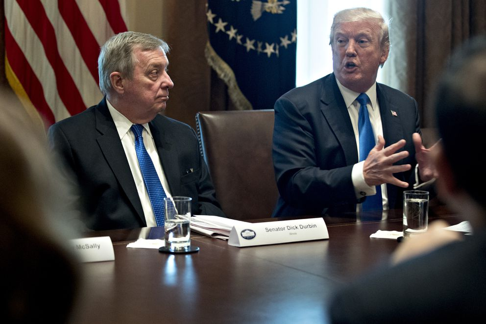 President Donald Trump speaks while Sen. Dick Durbin, D-Ill.(left) listens during a meeting with bipartisan members of Congress on immigration in the Cabinet Room of the White House in Washington, on Jan. 9, 2018.  (Bloomberg photo by Andrew Harrer)