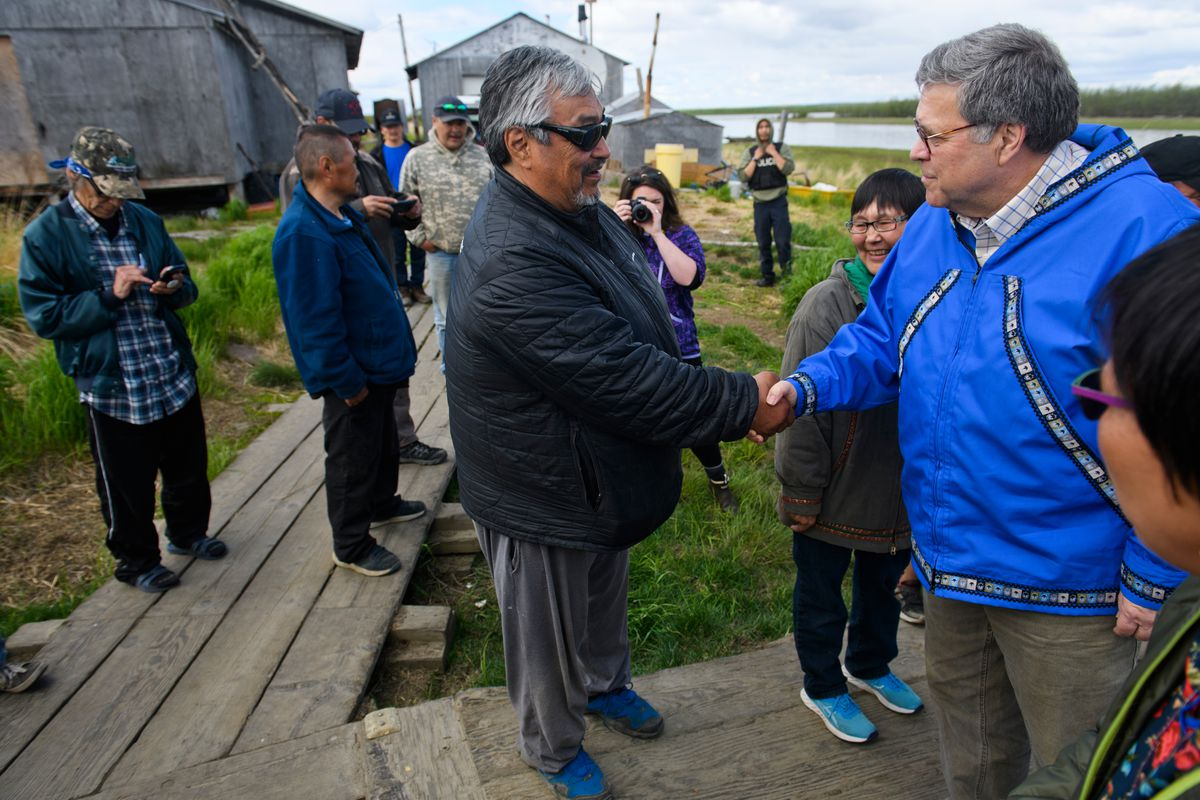 Mike Williams Sr. of Akiak greets U.S. Attorney General William Barr in Napaskiak on Friday, May 31, 2019. Barr visited Bethel and Napaskiak to learn about law enforcement and public safety challenges in the region. (Marc Lester / ADN)