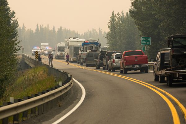 Traffic is stopped at mile 53 of the Sterling Highway on Sunday, Aug. 18, 2019. The road is closed in both directions due to the Swan Lake Fire. (Loren Holmes / ADN)