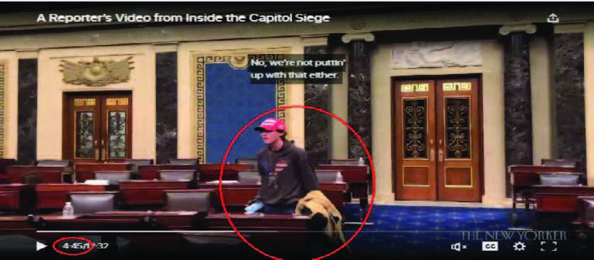 The FBI's criminal complaint against 18-year-old Bruno Cua of Milton includes this screen capture of a video that shows the moments that the U.S. Senate chamber was breached on Jan. 6. The FBI identifies Cua with a red circle. (USAO/FBI/TNS)