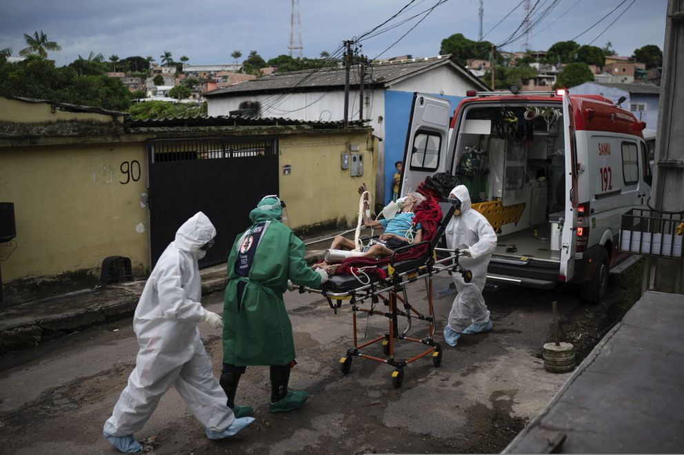 Emergency workers transfer an elderly patient, suspected of having COVID-19, to a hospital in Manaus, Brazil, Wednesday, May 13, 2020. Per capita, Manaus is Brazil's major city hardest hit by COVID-19. (AP Photo/Felipe Dana)