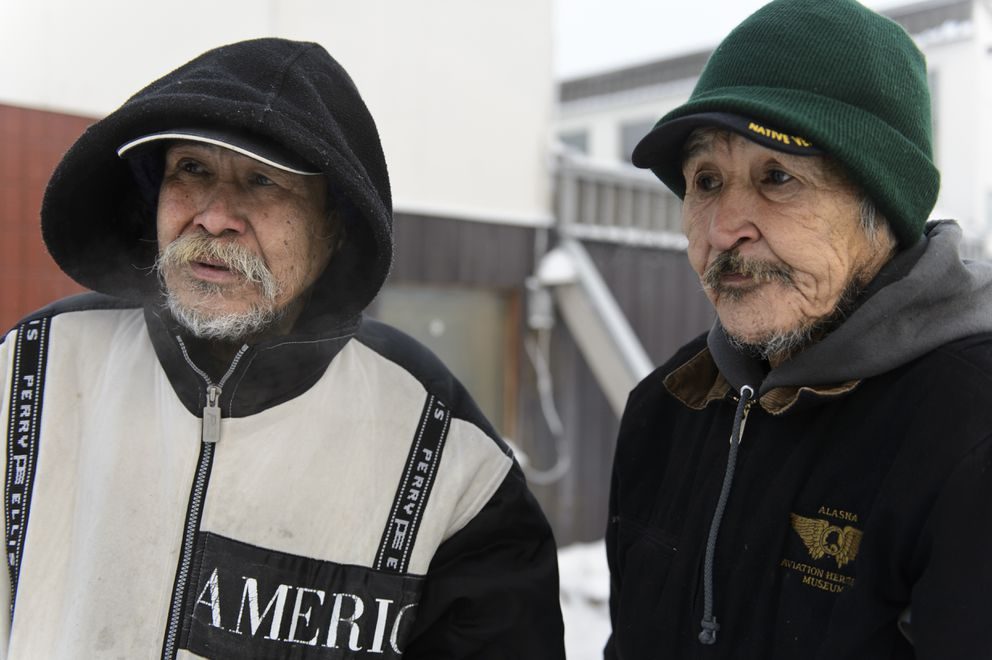 William Duny, 68, left and Steven Chya, 59, on January 6, 2020. Both have been staying at Bean's Cafe overnight and as parts of the day to stay warm, they said.(Marc Lester / ADN)