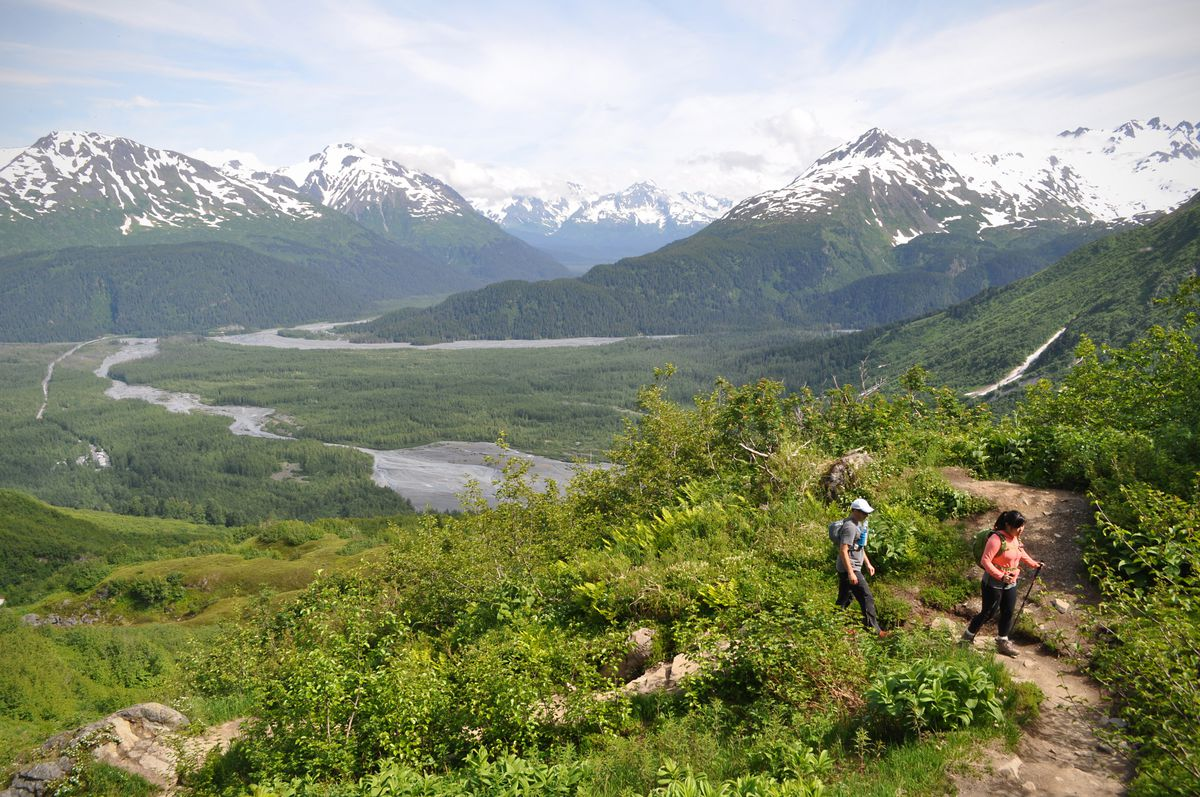 Jinyoung Chang, right, and Erik Easterly of the San Francisco Bay Area hike up toward the top of the cliffs on the Harding Icefield Trail on Saturday, July 2, 2016. (Vicky Ho / Alaska Dispatch News)