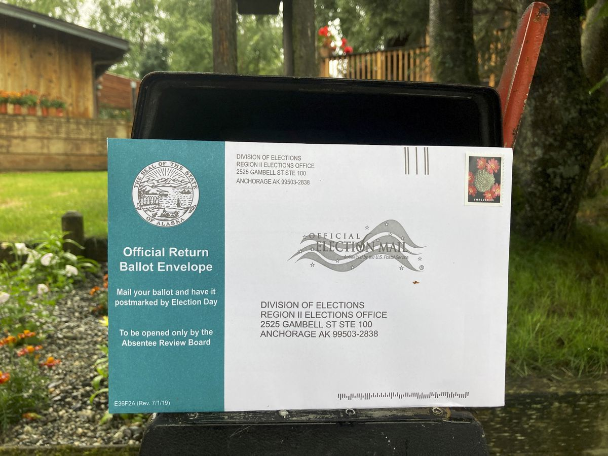 This Tuesday, Aug. 11, 2020 photo shows a completed Alaska Primary absentee ballot before it was put inside a mailbox in Anchorage. (AP Photo/Mark Thiessen)