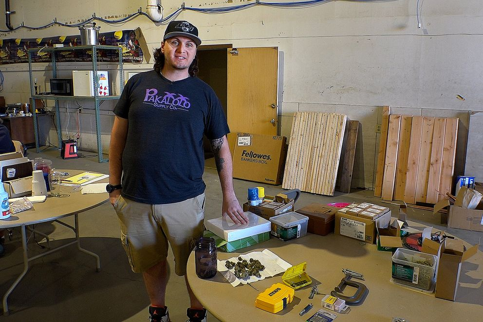 Keenan Hollister talks about starting up a marijuana cultivation and retail business at the warehouse he and his partners are leasing on May 30. (Scott Jensen / Alaska Dispatch News)