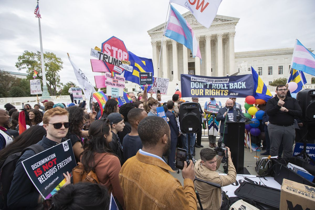 LGBT supporters gather in front of the U.S. Supreme Court, Tuesday, Oct. 8, 2019, in Washington. The Supreme Court is set to hear arguments in its first cases on LGBT rights since the retirement of Justice Anthony Kennedy. Kennedy was a voice for gay rights while his successor, Brett Kavanaugh, is regarded as more conservative. (AP Photo/Manuel Balce Ceneta)