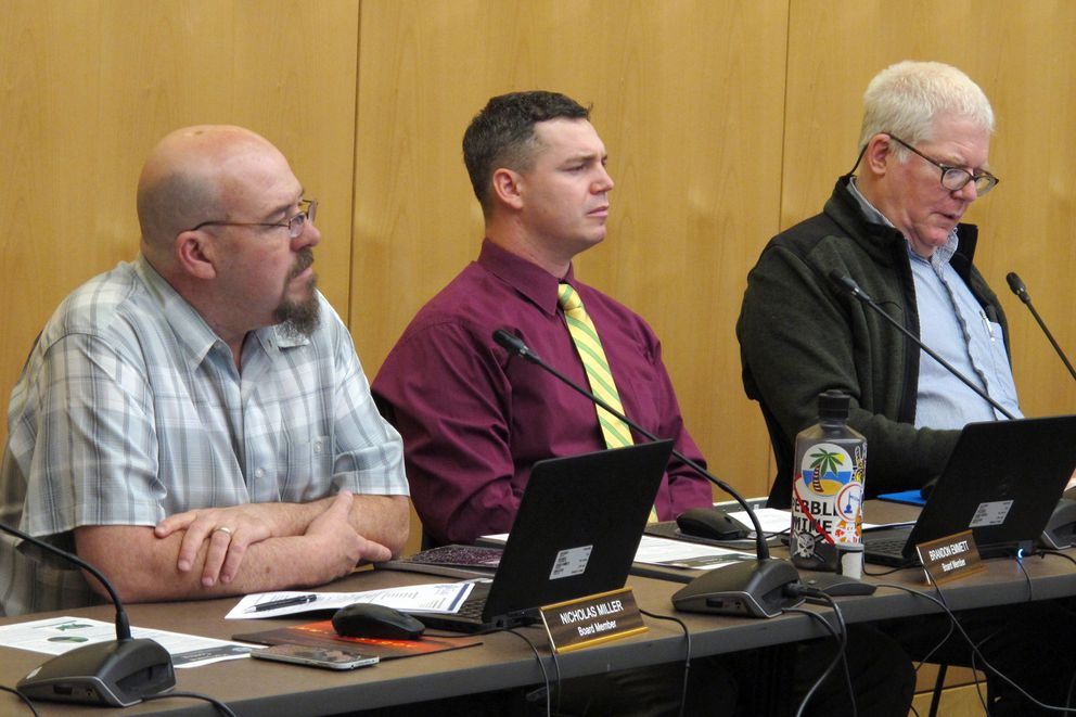 Members of Alaska's Marijuana Control Board listen to public comment during a meeting on Wednesday, Feb. 20, 2019, in Juneau, Alaska. Shown are, from left, Nicholas Miller, Brandon Emmett and Mark Springer. (AP Photo/Becky Bohrer)