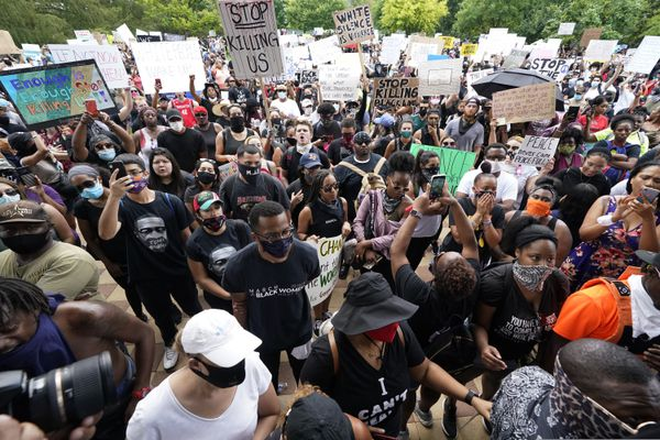 People gather to protest the death of George Floyd in Houston on Tuesday, June 2, 2020. Floyd died after a Minneapolis police officer pressed his knee into Floyd's neck for several minutes even after he stopped moving and pleading for air. (AP Photo/David J. Phillip)