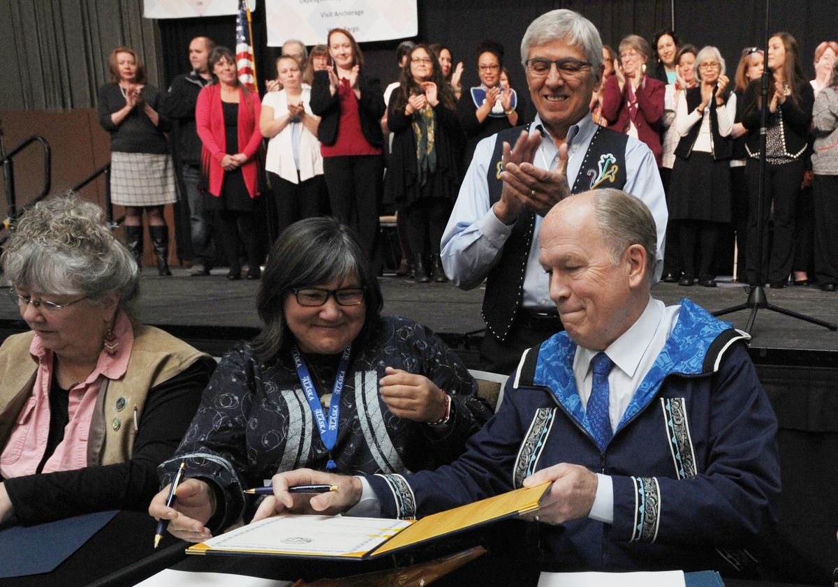 Department of Health and Social Services Commissioner Valerie Davidson, center, and Gov. Bill Walker sign the historic Alaska Tribal Child Welfare Compact on the first day of the Alaska Federation of Natives convention at the Dena'ina Center in Anchorage on Thursday. (Bill Roth / Alaska Dispatch News)