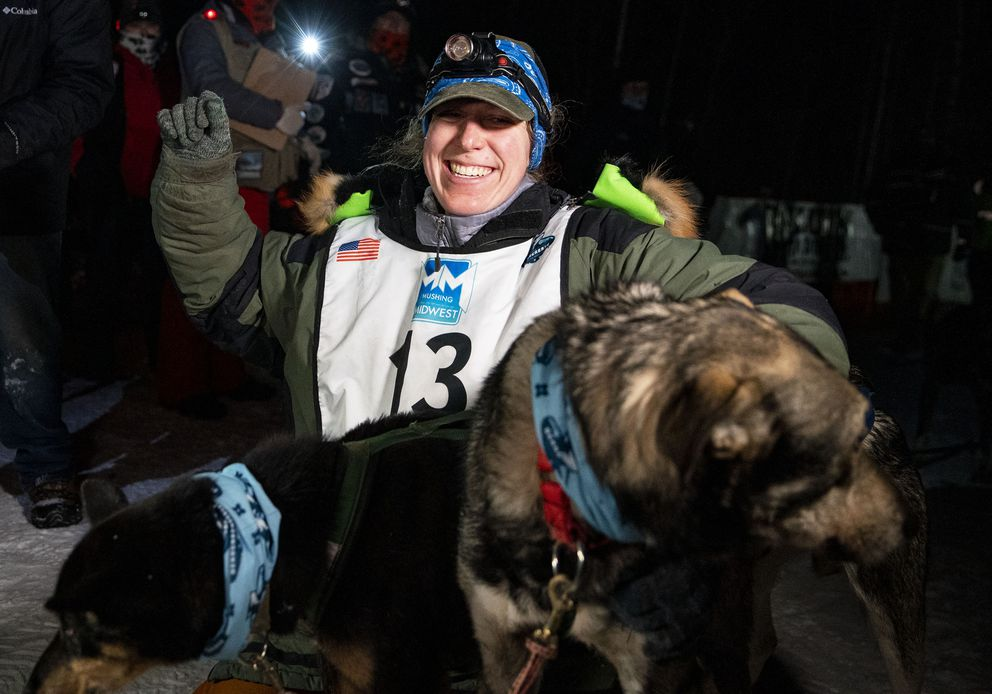 Erin Letzring celebrates with her lead dogs after becoming the first woman since 1998 to win the John Beargrease sled dog marathon. (Alex Kormann/Star Tribune via AP)