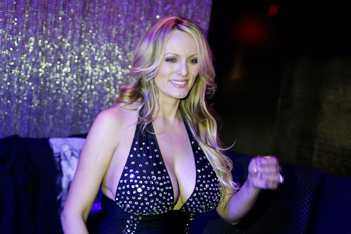 Adult-film actress Stephanie Clifford, also known as Stormy Daniels, poses for pictures at the end of her striptease show in Gossip Gentleman club in Long Island, New York, February 23, 2018. REUTERS/Eduardo Munoz/File