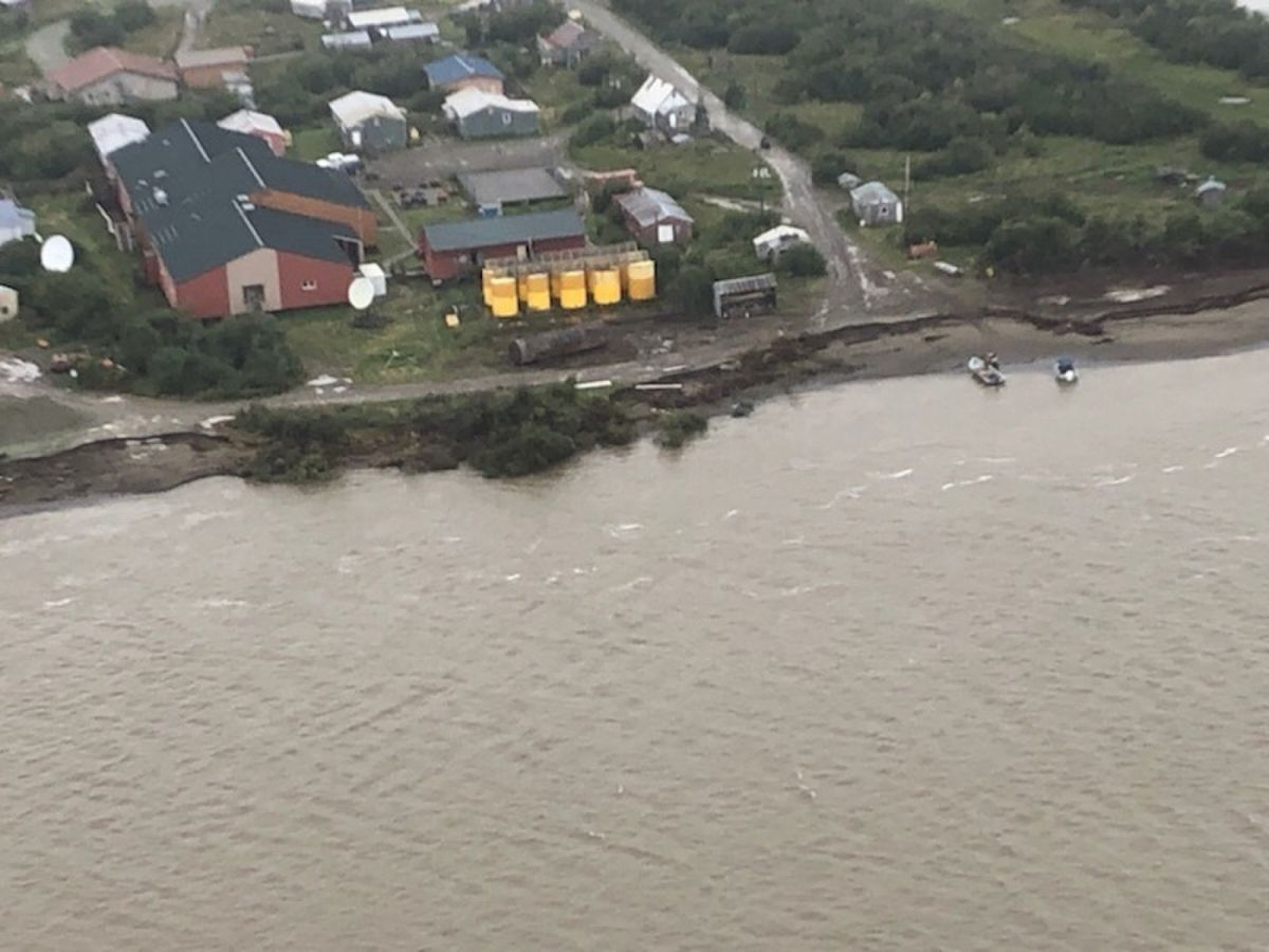 The Napakiak School fuel storage facility sits 76 feet from the riverbank's erosion point, along the Kuskokwim River in Napakiak, Aug. 16, 2019. (Photo courtesy Coast Guard)
