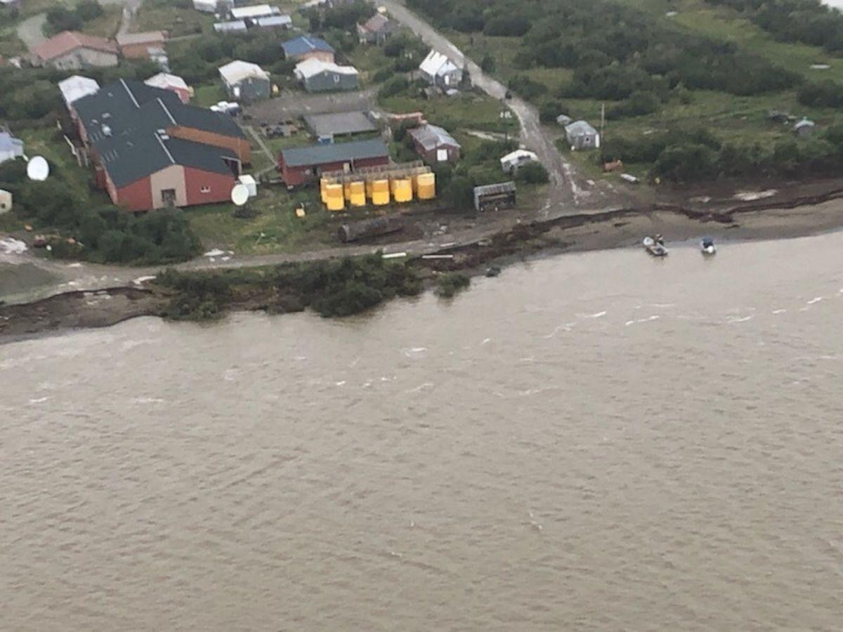 The Napakiak School fuel storage facility sits 76 feet from the riverbank erosion point, along the Kuskokwim River, Aug. 16, 2019. (Photo courtesy Coast Guard)