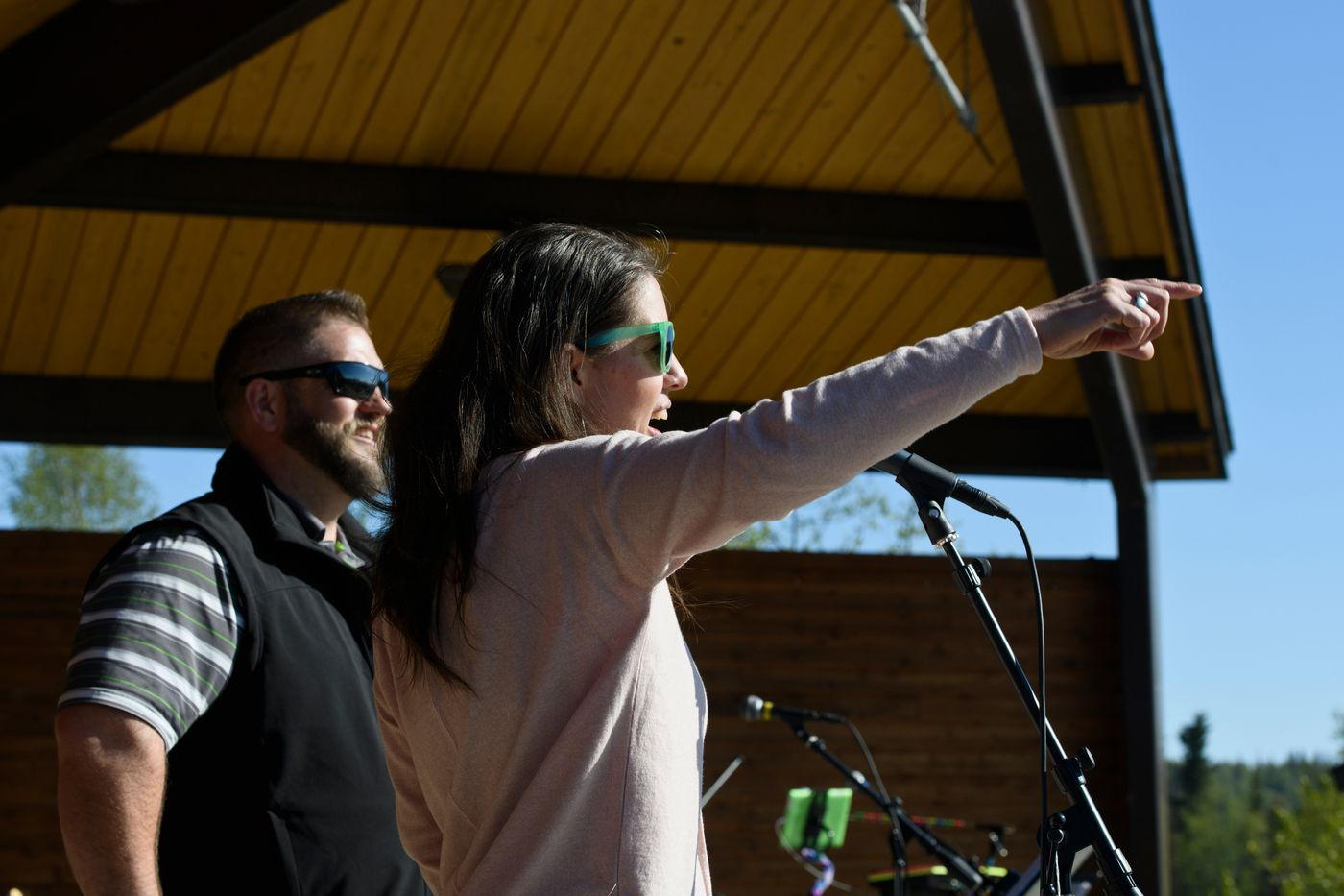 Anne Zink, Alaska's chief medical officer, speaks with the crowd at Sodotna's Party in the Park event at Soldotna Creek Park on May 26, 2021. She's joined by Alaska Department of Health and Social Services commissioner Adam Crum. (Marc Lester / ADN)