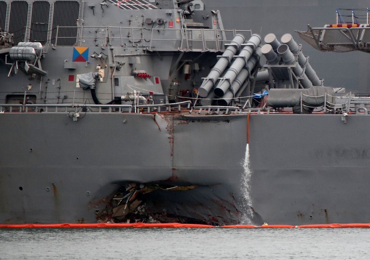 The damaged USS John McCain is docked at Changi Naval Base in Singapore. August 22, 2017. REUTERS/Calvin Wong