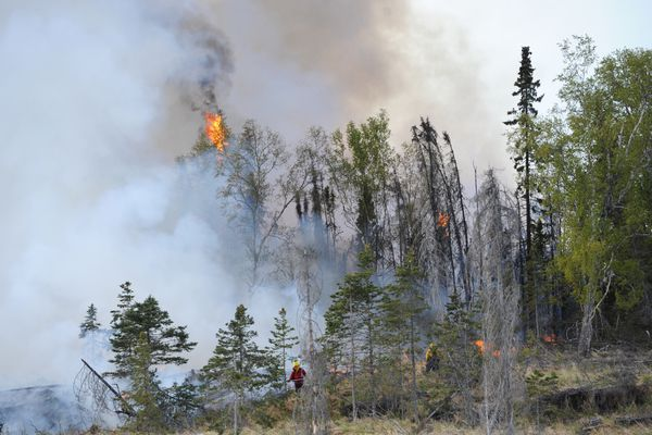 Firefighters battle the Sunrise wildfire near Meadow Lakes on Wednesday, May 4, 2016. (Bill Roth / Alaska Dispatch News)