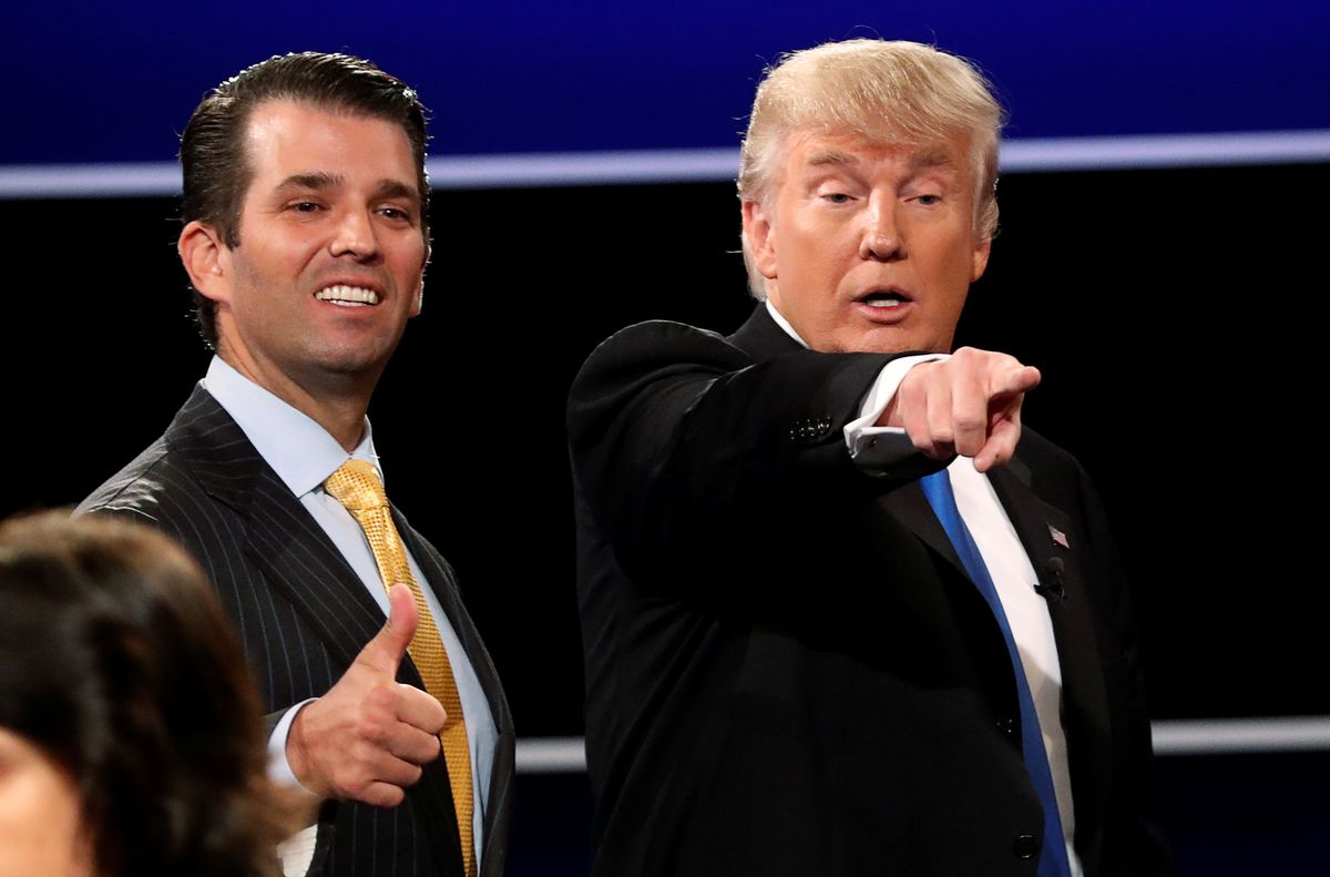 Donald Trump Jr. with his presidential candidate father in Hempstead, New York, September 26, 2016. REUTERS/Mike Segar/File