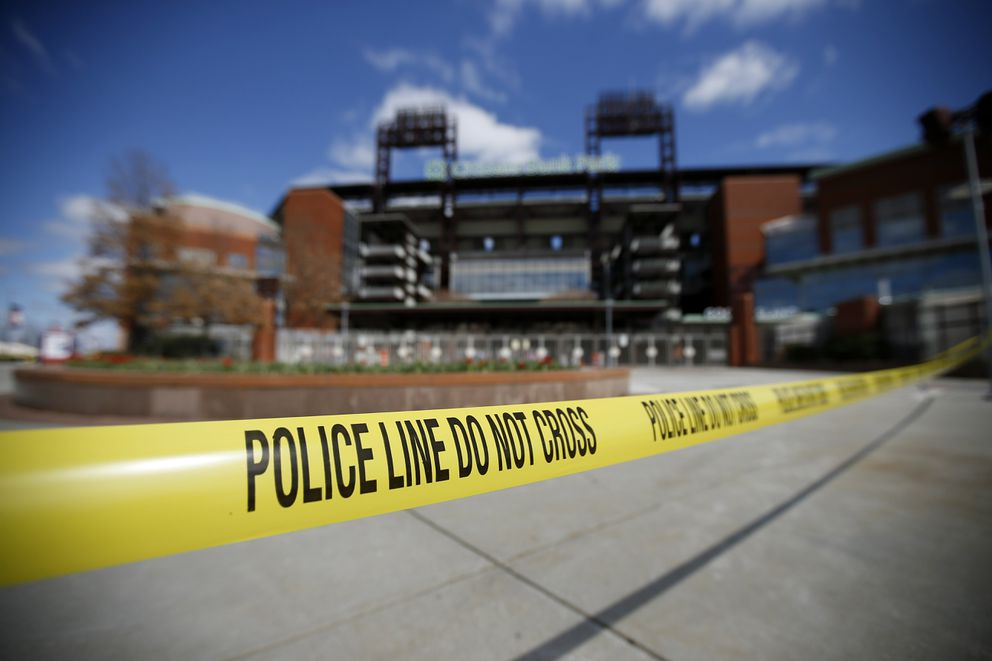 Police tape blocks an entrance to Citizens Bank Park, home of the Philadelphia Phillies baseball team, Tuesday, March 24, 2020, in Philadelphia. (AP Photo/Matt Slocum)