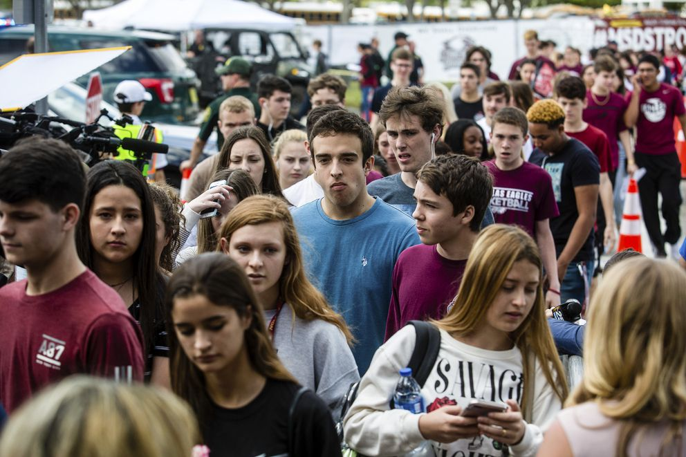 Students leave after classes at Marjory Stoneman Douglas High School in Parkland, Fla., Feb. 28, 2018. (Saul Martinez/The New York Times)