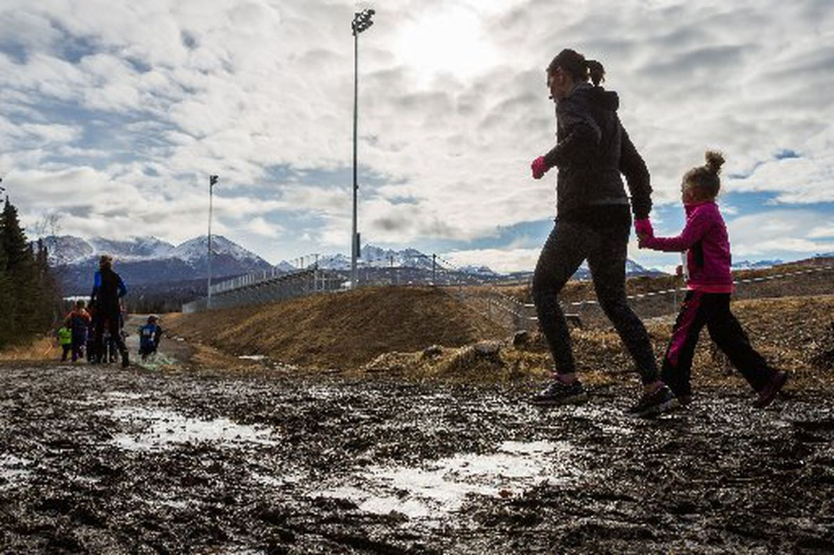 Participants navigate a semi-frozen trail near Service High School in the Tough Slusher, a noncompetitive race for kids, on April 11, 2015. The race was sponsored by Healthy Futures, a nonprofit that encourages physical activity for children. (LOREN HOLMES / ADN archive 2015)