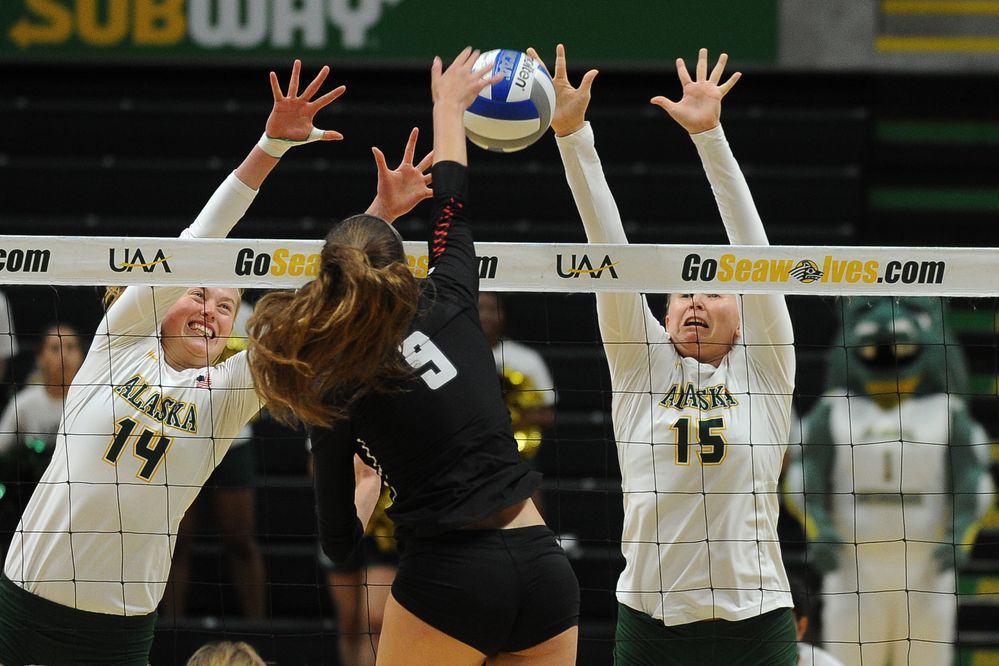 Vera Pluharova and Tara Melton, of the UAA Seawolves, go up to block against Brooke Foster, of the Northwest Nazarene Nighthawks, in volleyball action at the Alaska Airlines Center in Anchorage, AK on Thursday, Sept 6, 2018. UAA came from behind to win the first set. (Bob Hallinen / ADN)
