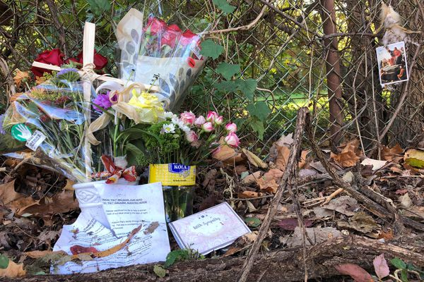 A impromptu memorial sits near the sidewalk in Arlington, Va., where Patricio Salazar tried to stop a sexual assault and was beaten so badly that he died. MUST CREDIT: Washington Post photo by Theresa Vargas