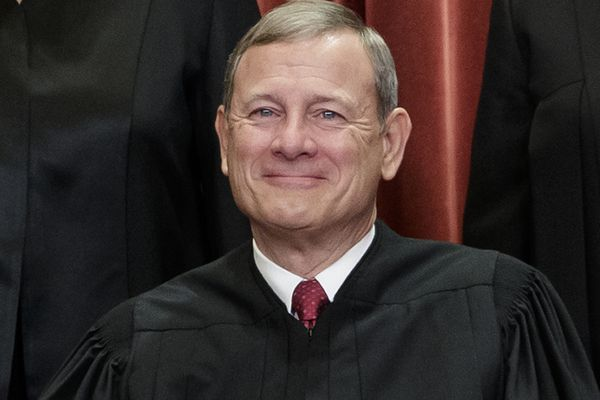 FILE - In this Nov. 30, 2018, file photo, Chief Justice of the United States, John Roberts, sits with fellow Supreme Court justices for a group portrait at the Supreme Court Building in Washington. Just hours after Chief Justice John Roberts handed Republicans a huge victory that protects even the most extreme partisan electoral districts from federal court challenge, critics blasted him as worthy of being impeached, a politician who should run for office and a traitor. (AP Photo/J. Scott Applewhite, File)
