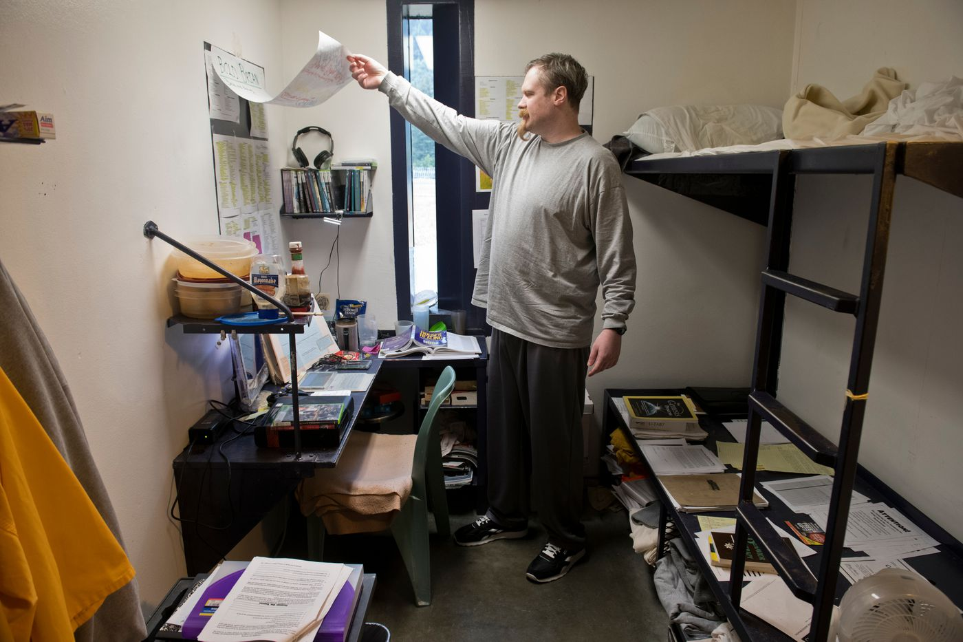 Prisoner Brian Radel is a senior coordinator for Real Solutions, the sober living mod inside Spring Creek Correctional Center. Radel said he writes the workbooks the group uses in his cell. (Marc Lester / ADN)