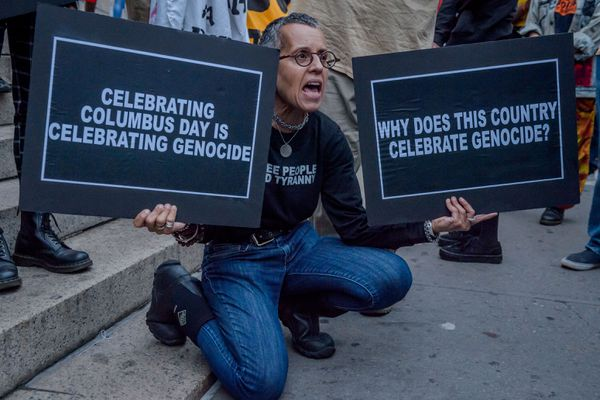 """An activist protests during the """"Anti- Columbus Day Tour"""" at New York City's American Museum of Natural History on October 8, 2018. (Tribune News Service)"""