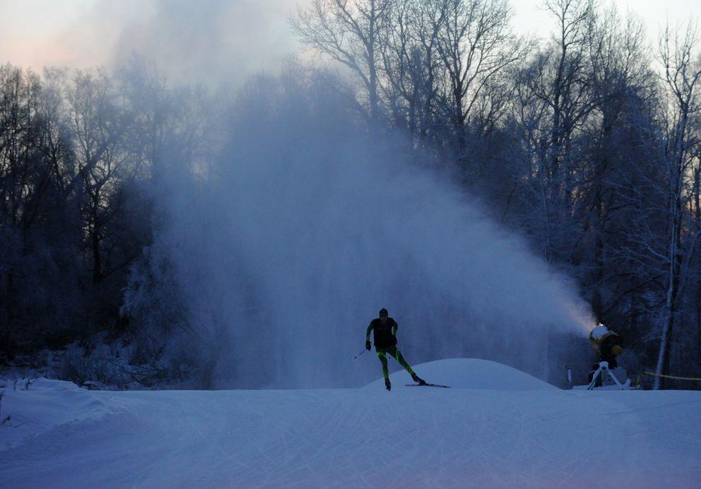 An APU nordic ski team member goesthrough a workout on man-made snow at Kincaid Park in Anchorage, December 2015. (Bob Hallinen / Alaska Dispatch News)