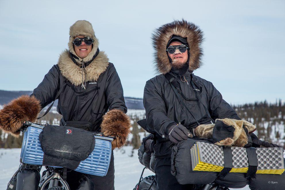 Bjørn Olson and Kim McNett pause to have their photo taken by Iditarod walker, Klaus Schweinberger, outside the village of Koyuk in March 2016.(Klaus Schweinberger)