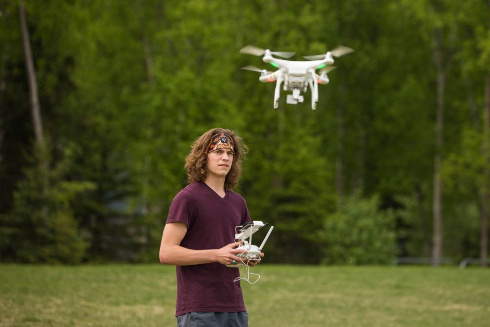 Recent South High graduate Ian Borowski flies a drone during a practice with the school's Unmanned Aerial Systems pilot program on Thursday, May 20, 2016. The drone pilot training program will be offered as an elective for credit next year, the first for high school students in Alaska. (Loren Holmes / Alaska Dispatch News)