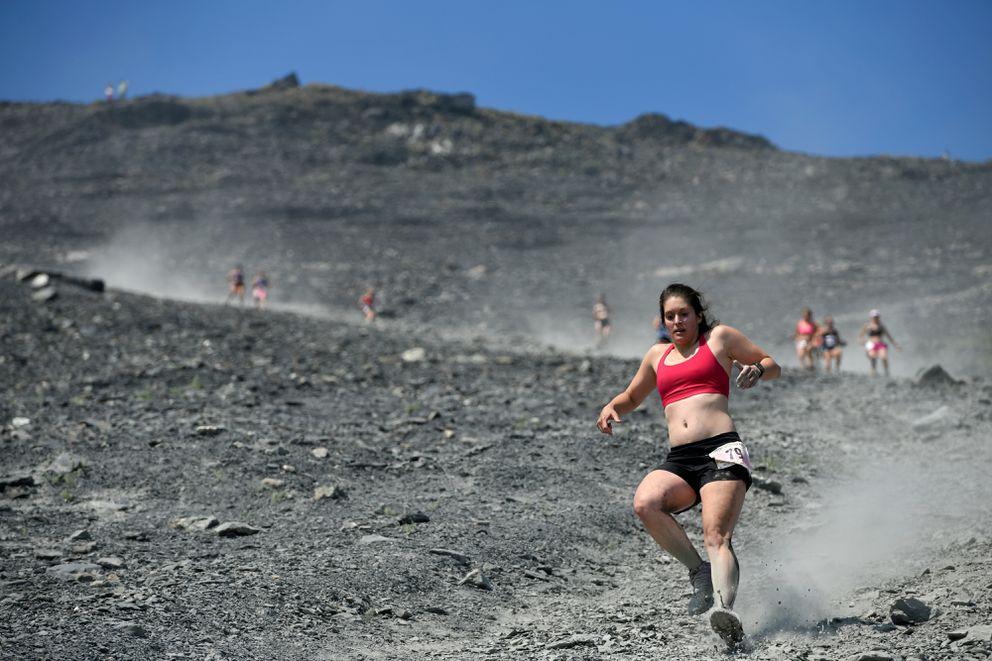 Jordin Thompson kicks up dust during the Mount Marathon women's race on July 4, 2019, in Seward. (Marc Lester / ADN)
