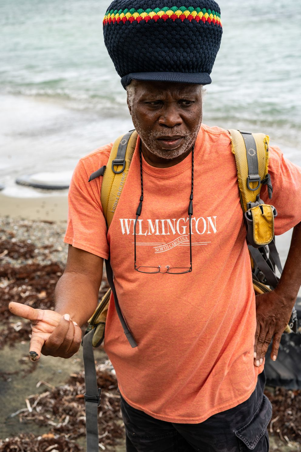 Olasee Davis, a professor of ecology and environmental preservation at the University of Virgin Islands, holds a sample of sand covered in oil near the Limetree Bay refinery in St. Croix on Wednesday, March 17, 2021. (Washington Post photo by Salwan Georges)