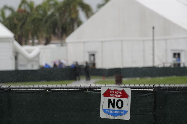 A No Trespassing sign hangs outside of the Homestead Temporary Shelter for Unaccompanied Children, Sunday, June 16, 2019, in Homestead, Fla. A coalition of religious groups and immigrant advocates said they want the Homestead detention center closed. (AP Photo/Lynne Sladky)