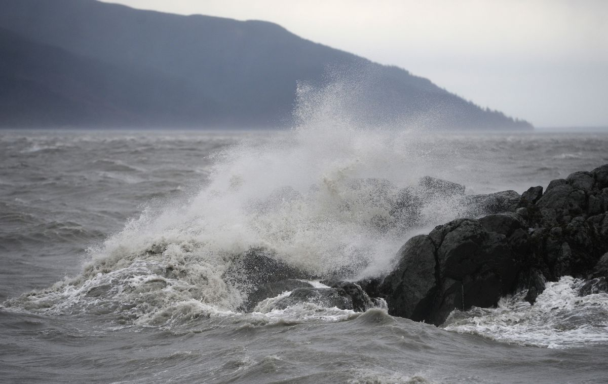Waves crash onto the rocks at Beluga Point as a weather front produced strong winds in Turnagain Arm on Wednesday.  (Bill Roth / Alaska Dispatch News)