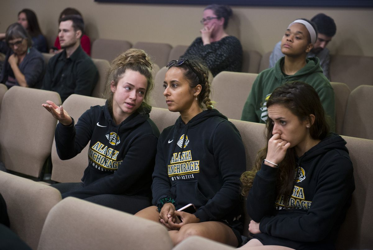 UAA gymnastics team members Isabelle Fox, Sophia Hyderally and Tere Alonso listen to University of Alaska Jim Johnsen's presentation. The University of Alaska Board of Regents voted to declare financial exigency on Monday, July 22, 2019, during a meeting at UAA's Gorsuch Commons. (Marc Lester / ADN)