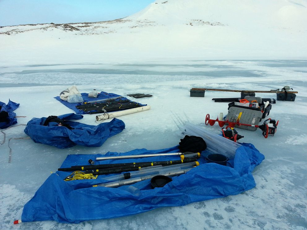 Equipment for collecting samples of lake sediment is laid out as part of a mammoth research project in 2013 on St. Paul Island. (Matthew Wooller)