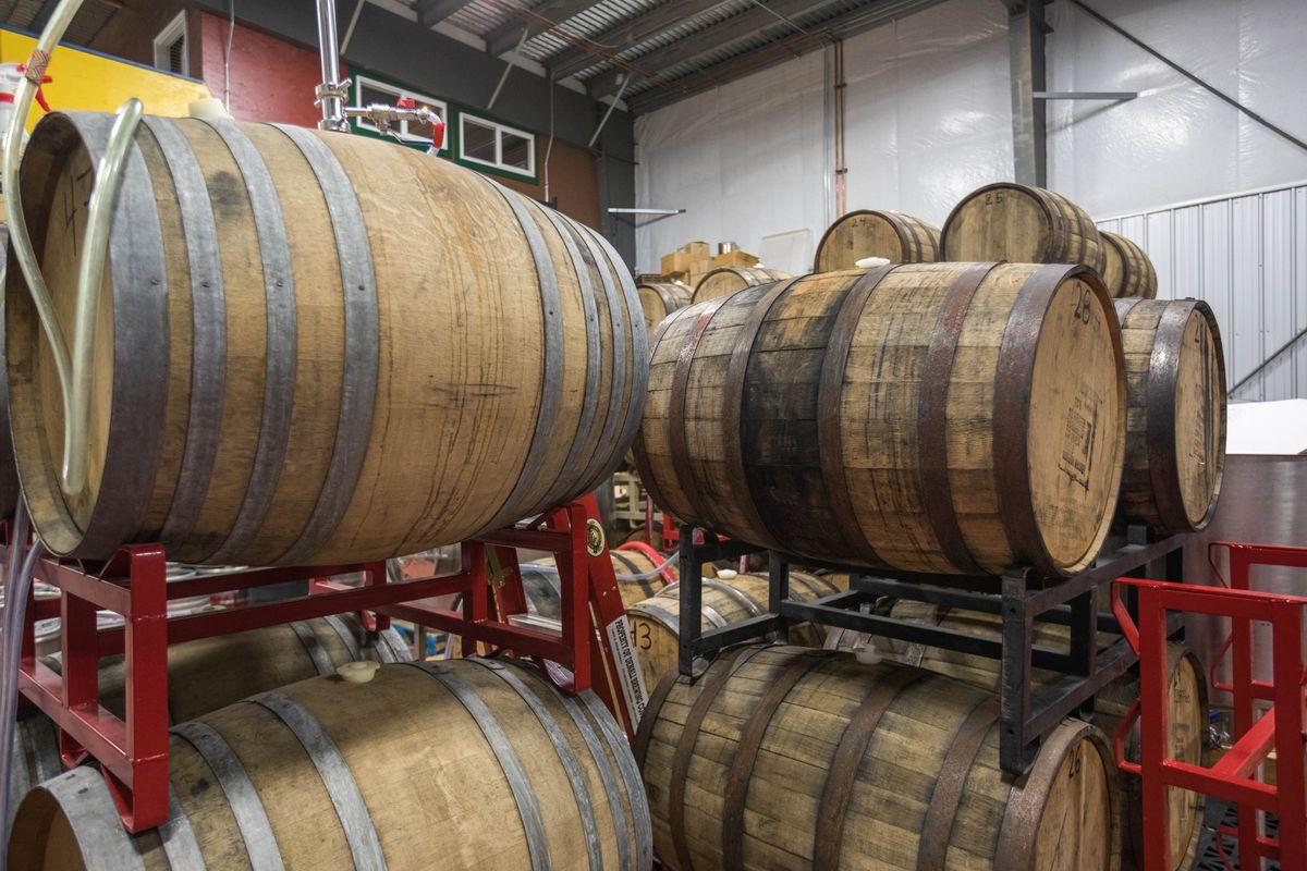 Beer ages inside wine and whiskey barrels at Denali Brewing Co. in Talkeetna on Nov. 10. (Loren Holmes / Alaska Dispatch News)