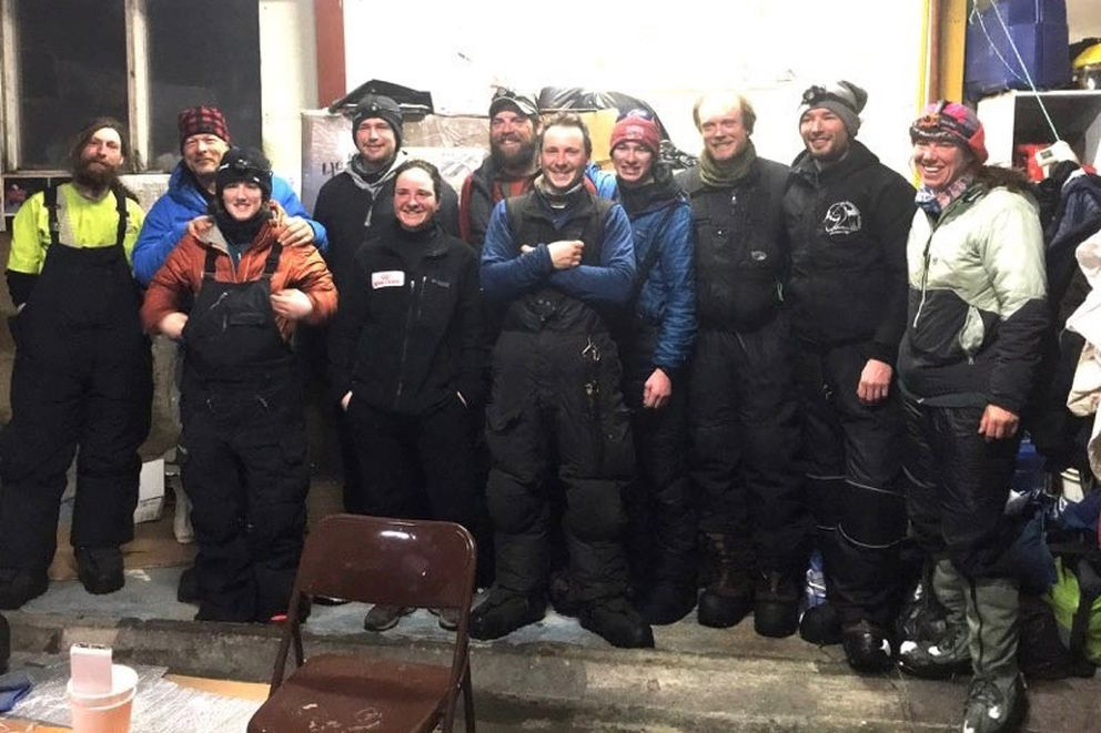The Elim 11 before the group returned to the trail Saturday morning. (Photo by Dave Dye via Iditarod Trail Committee)