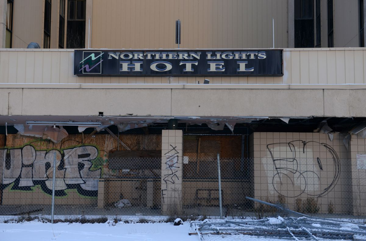 The Northern Lights Hotel sits boarded up and fenced off in Midtown Anchorage on Friday, Jan. 22, 2016. (Bob Hallinen / Alaska Dispatch News)