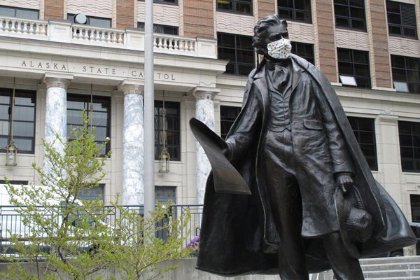 A statue of William Seward wears a mask outside the Alaska Capitol on Monday, May 18, 2020, in Juneau, Alaska. The Alaska Legislature planned to reconvene Monday to address use of federal coronavirus relief funds, with protocols in place aimed at guarding against the virus. (AP Photo/Becky Bohrer)