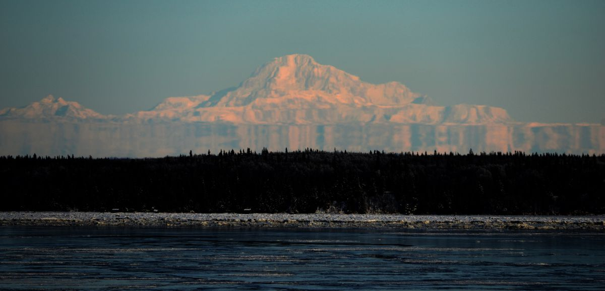 Fata Morgana forms on the lower slopes of Denali in this view from Point Woronzof earlier this year. (Bob Hallinen / ADN)