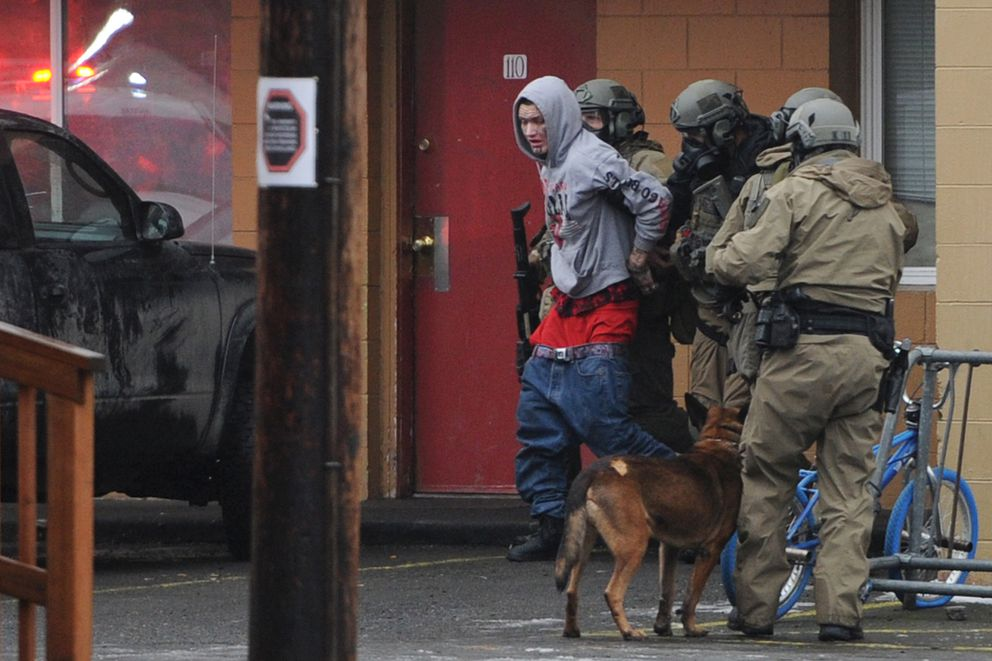 Ryan Edwin, 22, peacefully surrendered and was arrested by Anchorage Police SWAT officers after a standoff at the Backpackers Inn on Sunday, Nov. 18, 2018. (Bill Roth / ADN)