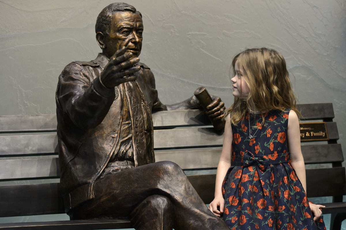 Megan Becker, 5, takes a look the statue of her grandfather, Ted Stevens, whom she never had a chance to meet. Becker is the daughter of Lily Stevens Becker, Ted Stevens' daughter. A bronze statue of Ted Stevens was unveiled during a ceremony at Ted Stevens Anchorage International Airport on February 23, 2019. Stevens, who died in 2010, served in the U.S. Senate for 40 years. (Marc Lester / ADN)