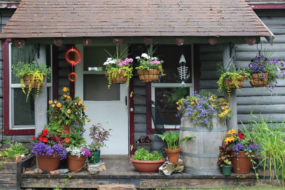Sheila Macias's porch decorated with flowers and fossils on Friday, July 19, 2019. (Photo by Lauren Ellenbecker)